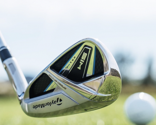 TaylorMade SIM Max iron with ball teed up on grass