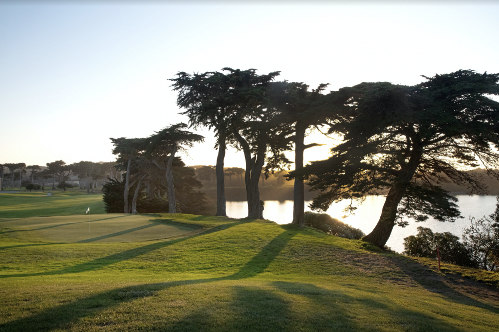 The signature 18th hole plays along Lake Merced. All photos courtesy of TPC Harding Park.