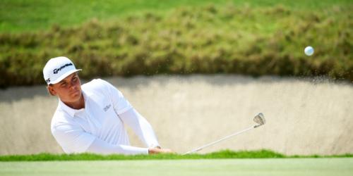 Sami Valimaki hitting a golf shot out of a bunker