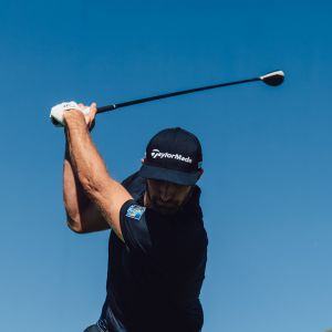 Dustin Johnson at the top of golf backswing