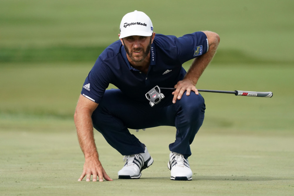 Dustin Johnson made a sidewinding putt on the 72nd hole to force a playoff.